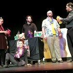 Cast with leis onstage