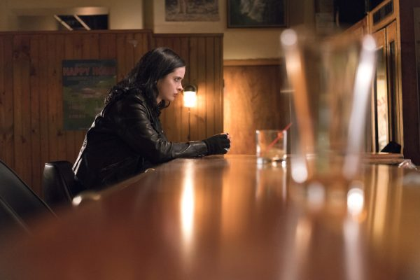 Jessica sits alone at a bar