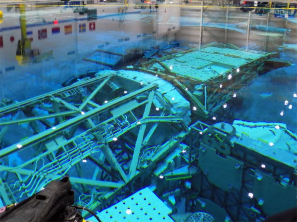 A to-scale model of the international space station in a larger-than Olympic-sized swimming pool