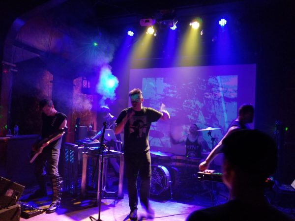 Band members of Cyanotic on stage