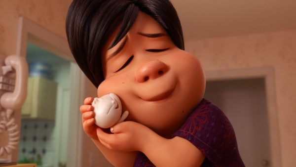 A person cuddles an anthropomorphic dumpling