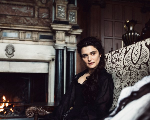 Profile photo of Rachel Weisz's character in front of a fireplace.