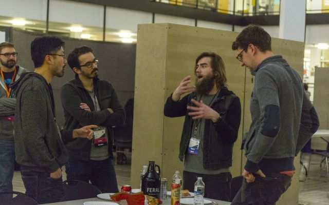 Four designers brainstorm over a growler of beer. (Photo T.A. Wardrope)