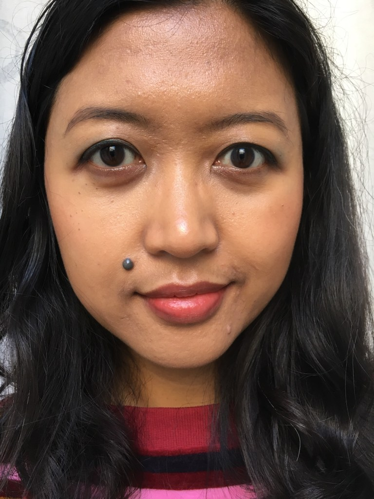Wearing Chanel Rosso Pompeiano lightly on the lips