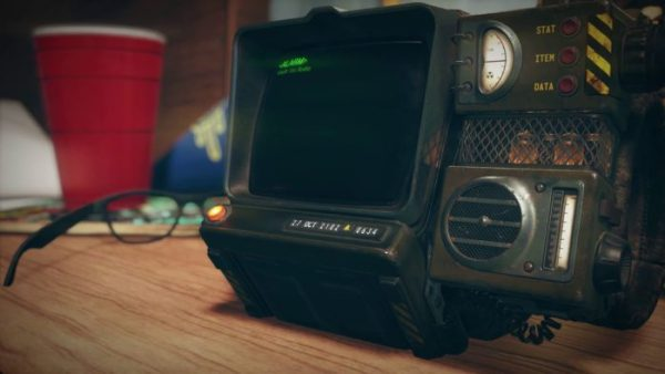 Fallout 76: A Robco Pip Boy 3000, playing the song Take Me Home, Country Roads on Vault-Tec Radio as an alarm. The date is set to October 27, 2102