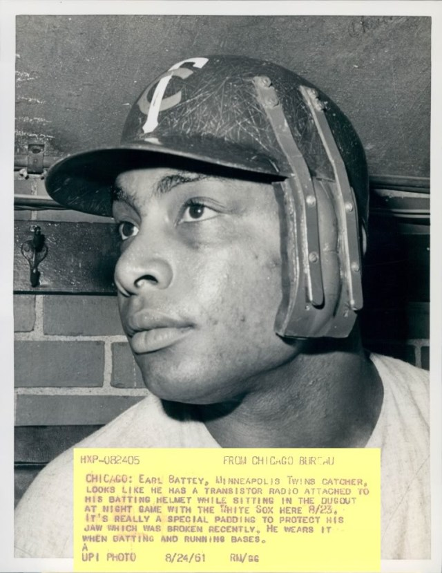 Catcher Earl Battey with special batting helmet