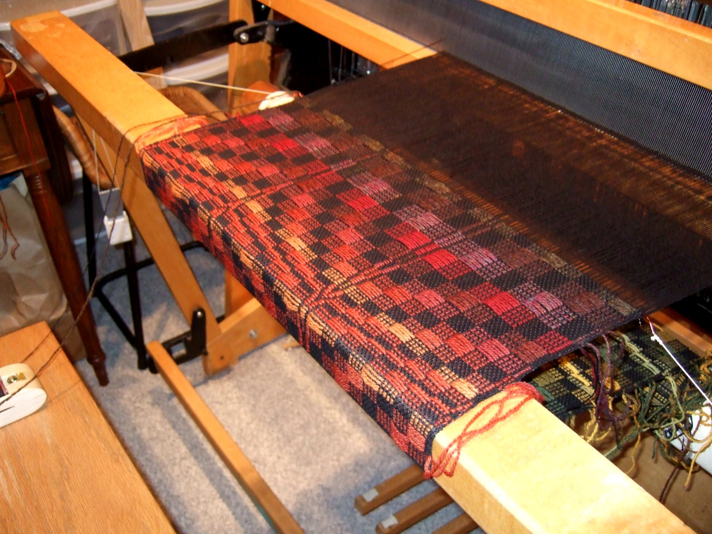 """John Madison"" mat 2, treadling II from M.P. Davison, in reds"