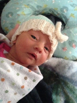 My baby #7 in her preemie-sized hat I had to knit for her