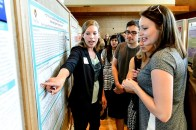 Students presents their research projects to attendees at the Undergraduate Research Symposium hosted in Varsity Hall at Union South at the University of Wisconsin-Madison on April 17, 2015. The annual event showcases student-led research, creative endeavors and service-learning projects. (Photo by Bryce Richter / UW-Madison)