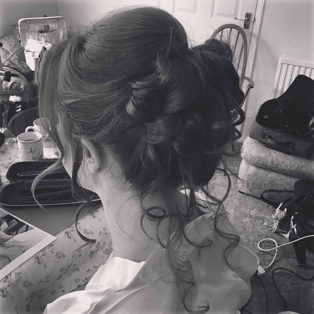 A loose chignon with tendrils