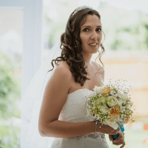 Bride posing with her bouquet