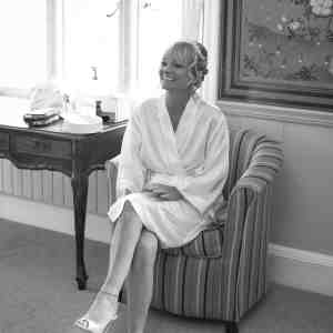 A bride in her dressing gown and heels