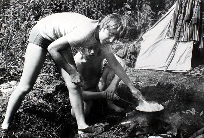 Angela Merkel Prepares A Meal On A Campfire While Camping With Friends In Himmelpfort, German Democratic Republic In July 1973