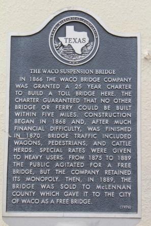 Historical marker for the Waco suspension bridge.