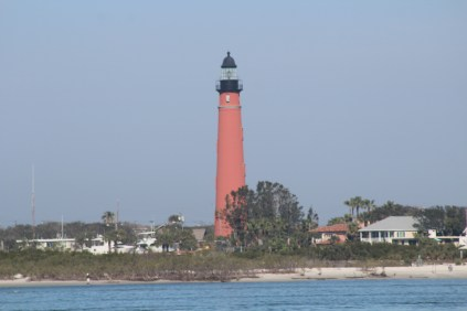 I think this is the Ponce de Leon Inlet Lighthouse, as seen across the bay from the boardwalk at Smyrna Dunes.