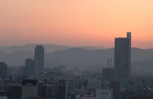 The sun setting beyond the hills that surround Hiroshima.