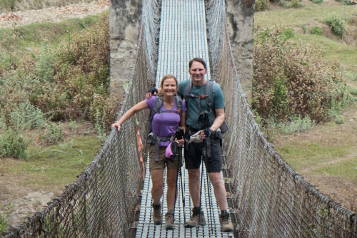 Crossing one of the many suspension bridges in Bhutan.