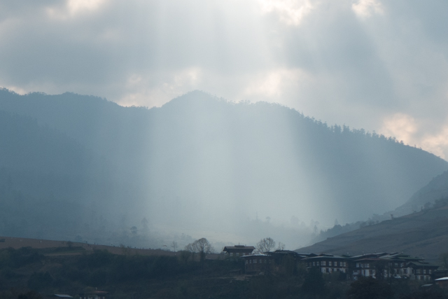This was a very special view for us.  The sun was streaming through the hole in the cloud, and was filtered by the haze.