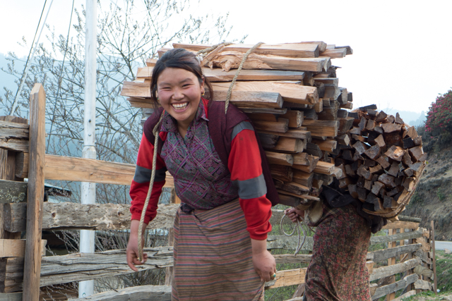 These young women were carrying huge loads of wood....and smiling about it!
