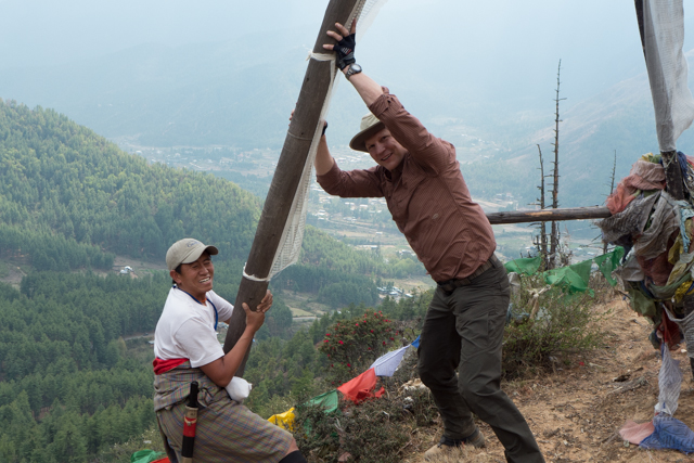 Mark and Jigme raising the 35 foot pole.