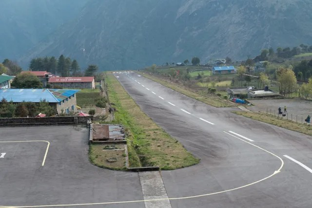 The Tenzing-Hillary Airport at Lukla.  The runway is 1,509 by 66 feet with a 12% gradient. The elevation of the airport is 9,400 ft.  Aircraft can only use runway 06 for landings and runway 24 for takeoffs. There is no prospect of a successful go-around on short final due to the terrain. There is high terrain immediately beyond the northern end of the runway and a steep drop-off at the southern end of the runway into the valley below.