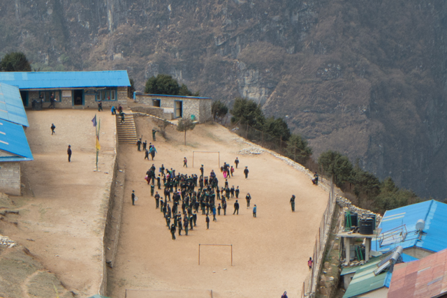 Local school in Namche Bazar. The L-shaped buildings with a big recreational yard, uniforms and soccer goals were very common.