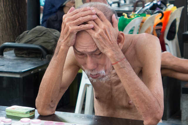 A Chinese Checkers player in the throes of concentration.