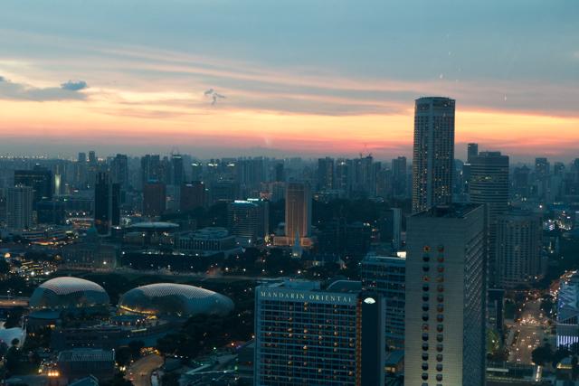 Singapore's skyline in the setting sun.