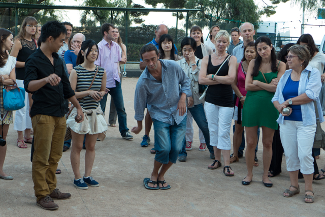 Julien, showing us how to play pétanque, one of the pastimes of southern France.  Pétanque is a form of boules where the goal is to throw hollow metal balls as close as possible to a small wooden ball while standing inside a starting circle with both feet on the ground.