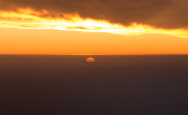 Just when we thought the sun had set, we realized that it had only sunk behind a cloud layer.