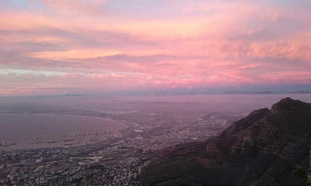 The view of the town underneath the pink clouds was stunning.