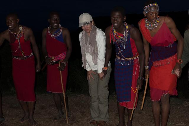 Local Maasai giving Shauna a dancing lesson.