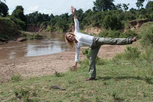 The hippos and crocs watch with amusement as Shauna practices yoga along the banks of the Mara River, which runs through the National Reserve.