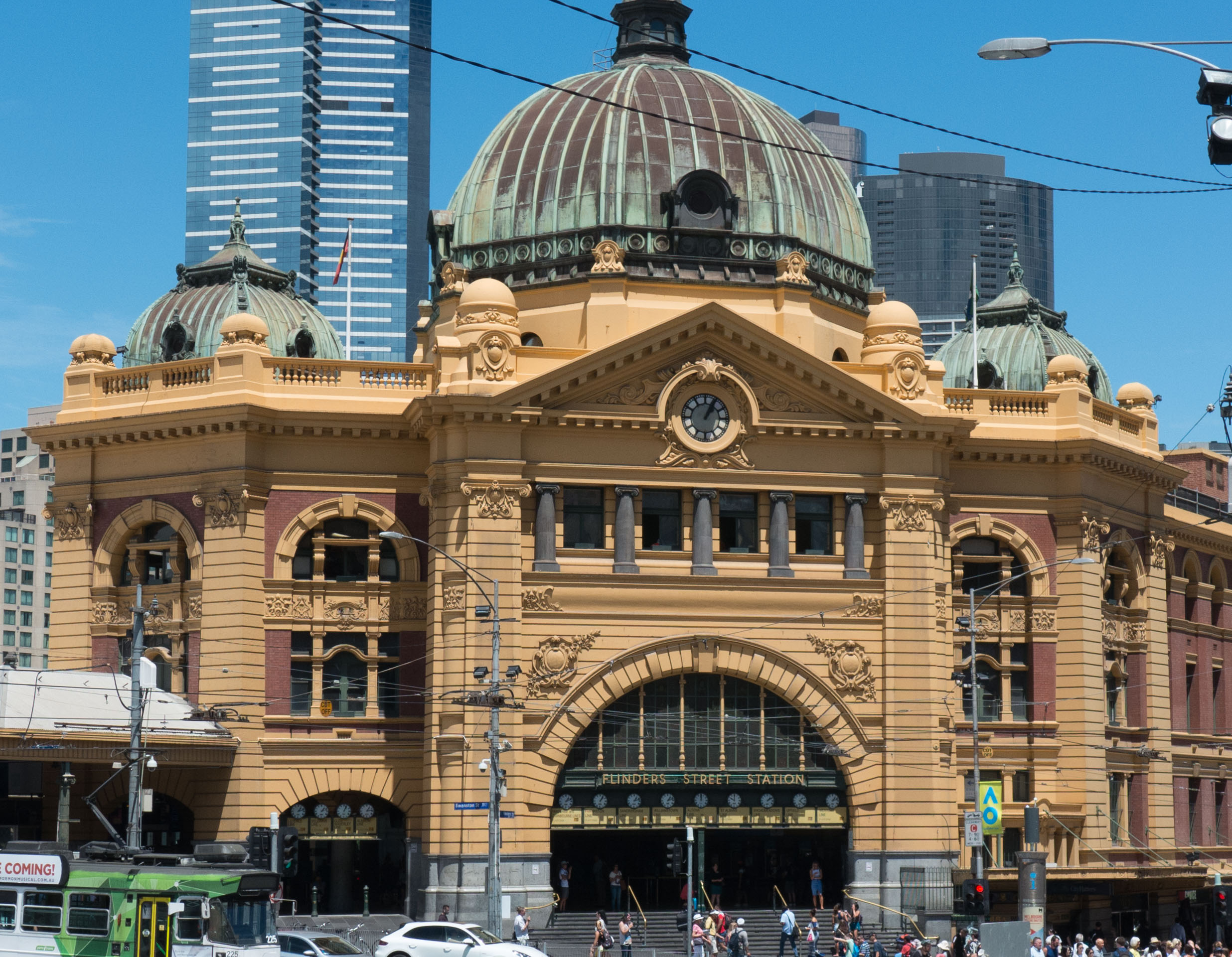 Flinders Street railway station is a railway station on the corner of Flinders and Swanston Streets in Melbourne, It is the heart of the entire metropolitan rail network. Backing onto the city reach of the Yarra River in the heart of the city, the complex covers two whole city blocks.