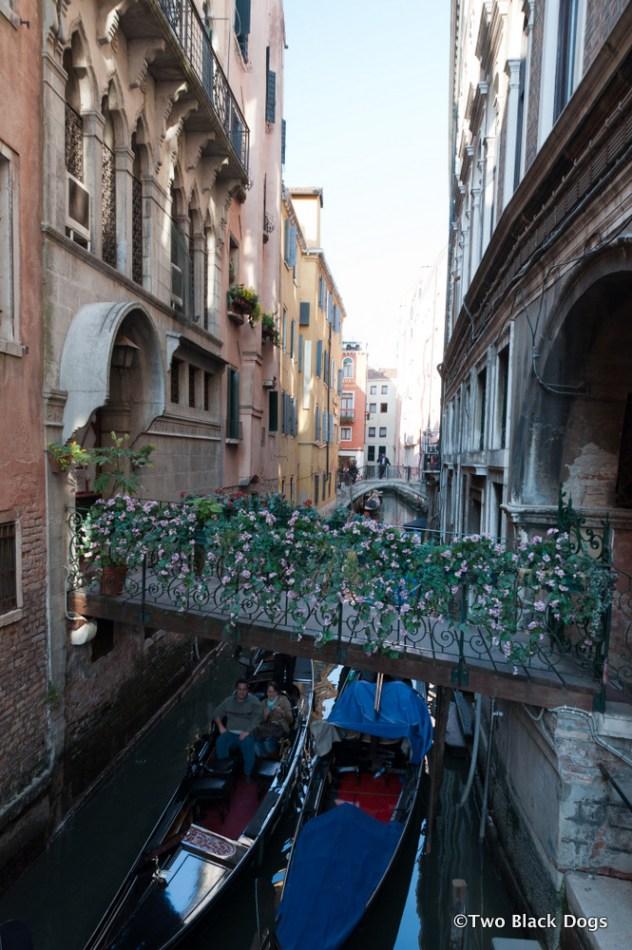 Venetian bridge covered in flowers