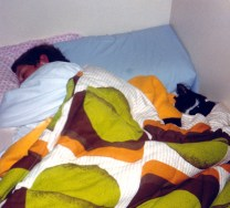 My brother sleeping with Cecil the cat