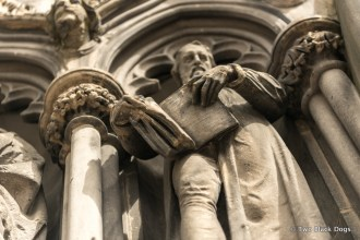 Carving of man with book