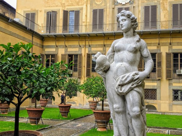 Statue of woman and lemon trees in garden at Medici Palace