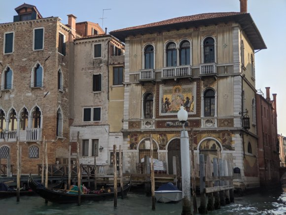Building with gold leaf painting in Venice Italy