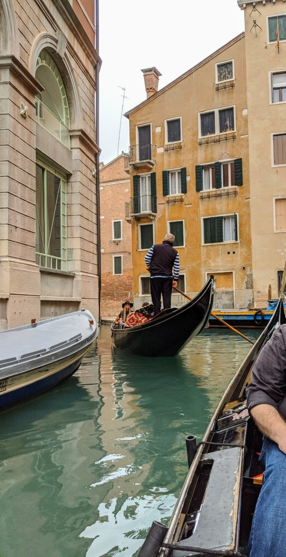 Gondolier standing at the head of his boat