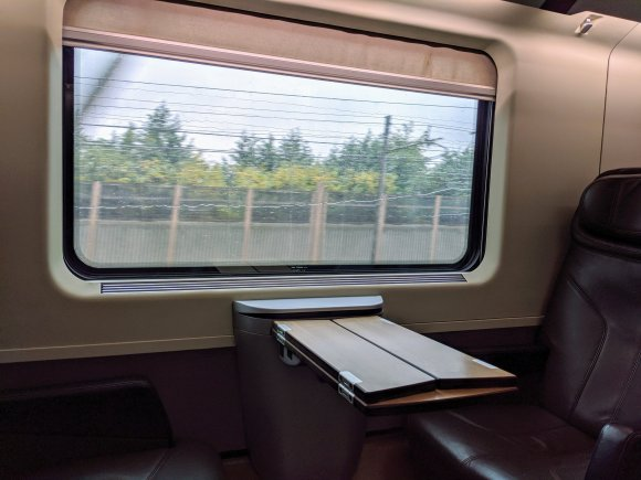 Empty train seat with view out the window