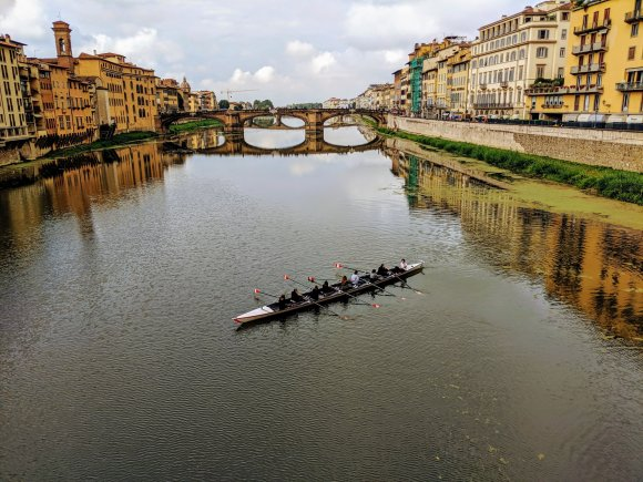 People rowing on Arno River in Florence, Italy