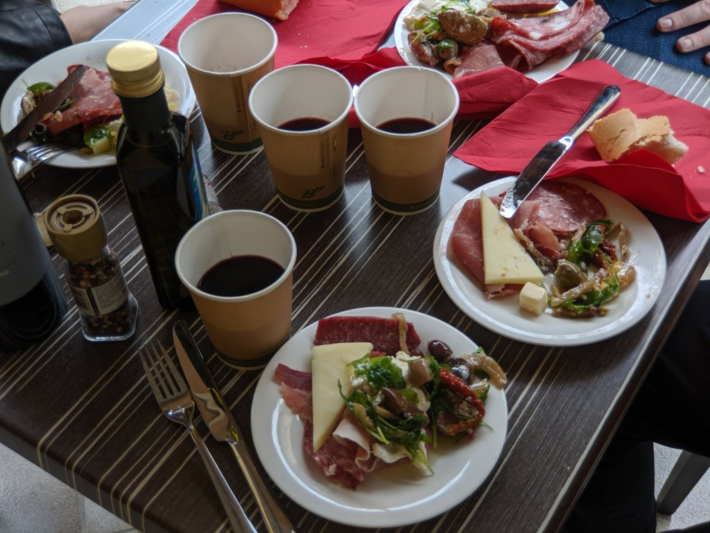 Picnic lunch on the balcony of the Hotel della Signoria in Florence, Italy