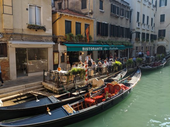 Two empty gondolas parked outside a restaurant