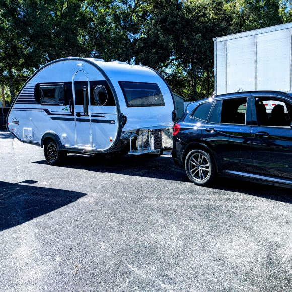 BMW X3 towing a nuCamp TAB 400.