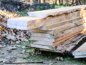 "stack of freshly milled, 2"" x 13"" cedar planks"