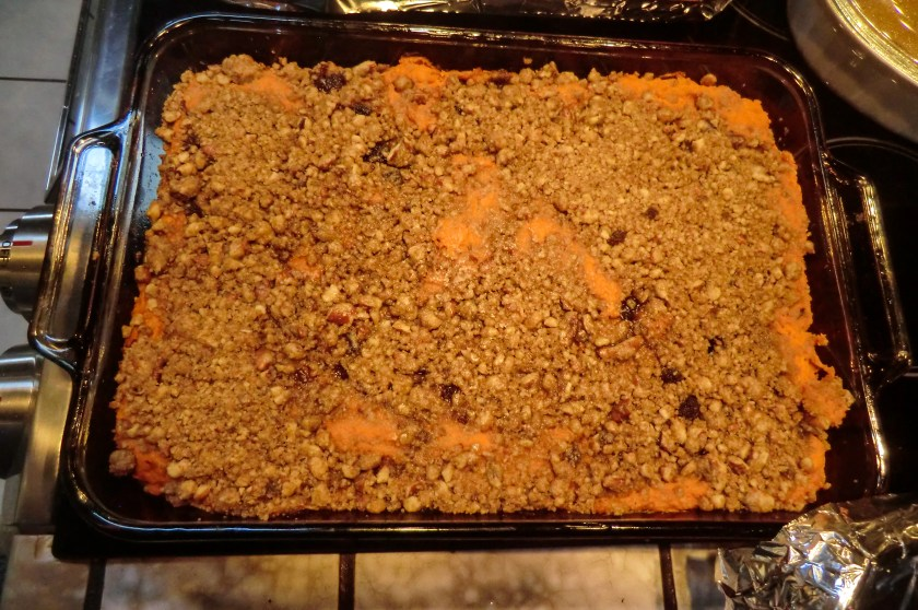 a casserole dish of yams mixed with cream, sugar, and walnuts
