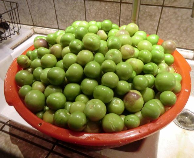 a bowl of green tomatillos