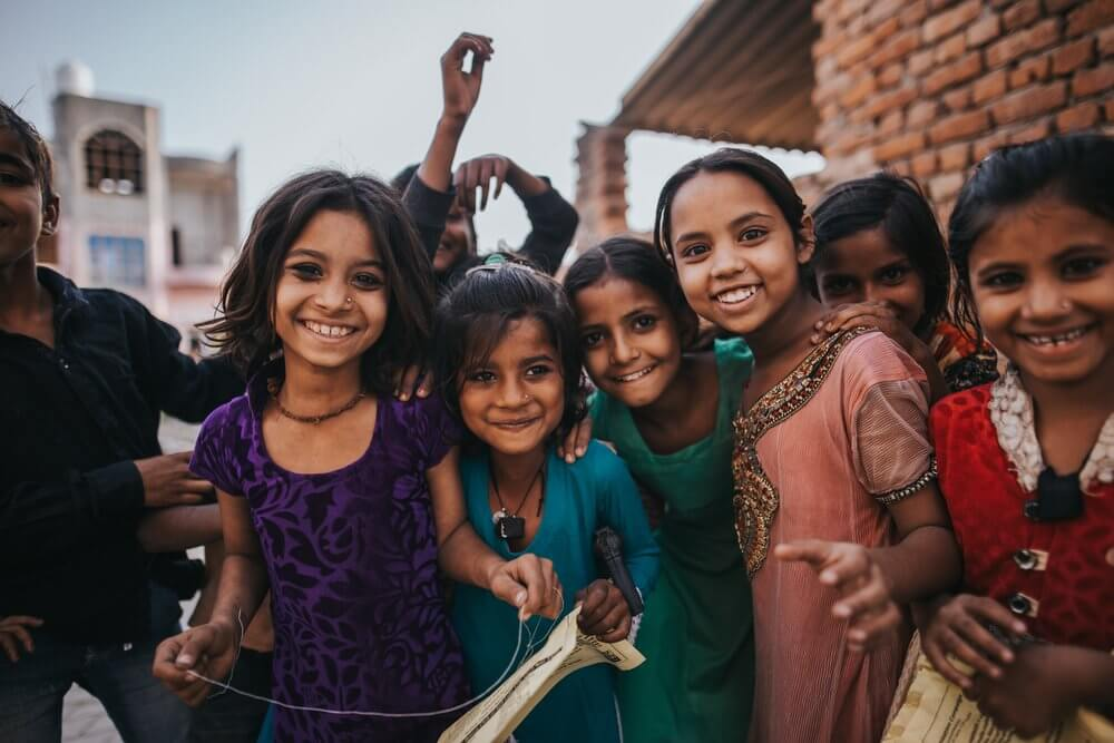 a small group of Indian children smiling