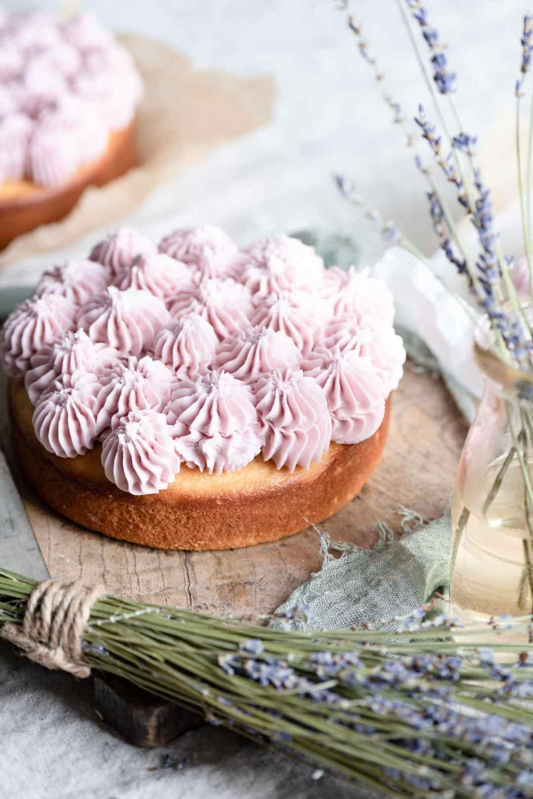 Fluffy white cake with purple frosting.